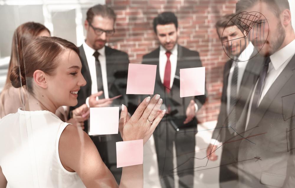 a corporate team going through a leadership workshop