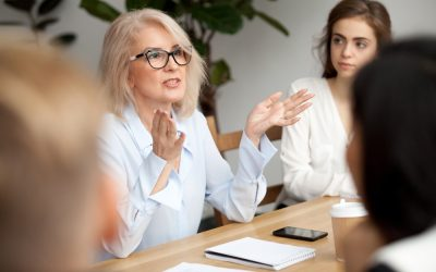 woman conducting a meeting with her team